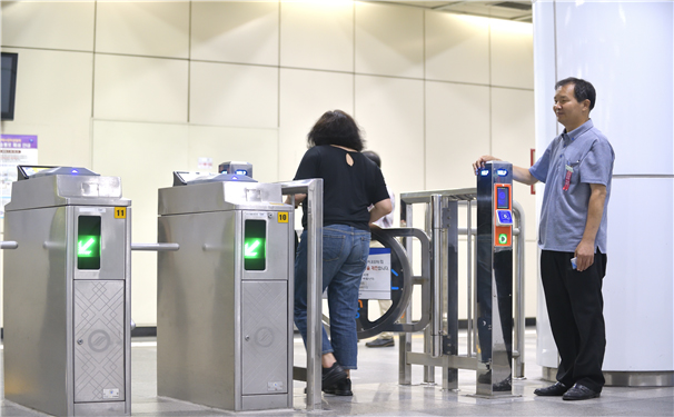 A passenger using the emergency gate