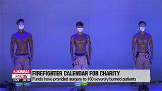 Seoul firefighters sell calendars to help burn victims